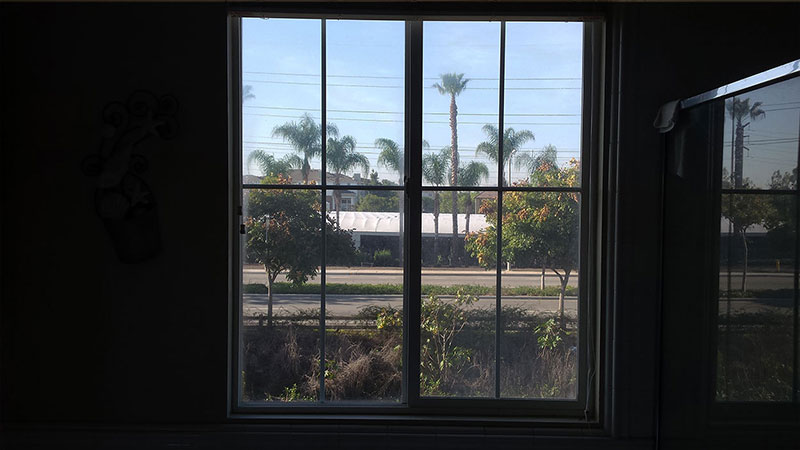 Picture of window before window cleaning in Irvine by Blue Coast Window Cleaning Service.