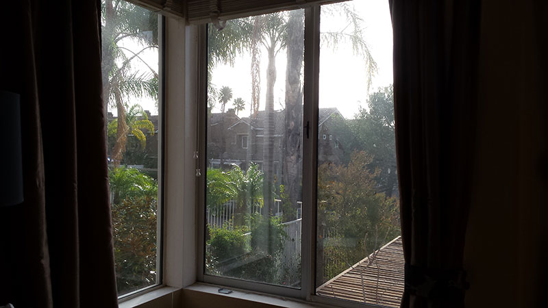 Picture of window before window cleaning in Newport Beach by Blue Coast Window Cleaning Service.
