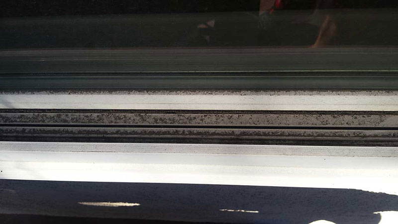 Picture of window track after window cleaning in Irvine by Blue Coast Window Cleaning Service.